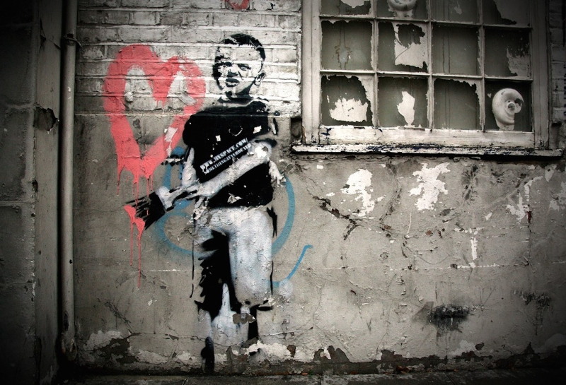Banksy (British, 1974) Heart Boy, 2009. Measurements: 87 in x 43 in x 18 in (220 cm x 110 cm x 45 cm). Materials: Black aerosol stencil, pink acrylic on concrete and white-washed brick.Weight: 2000 kg (PRNewsFoto/Moco Museum Amsterdam)